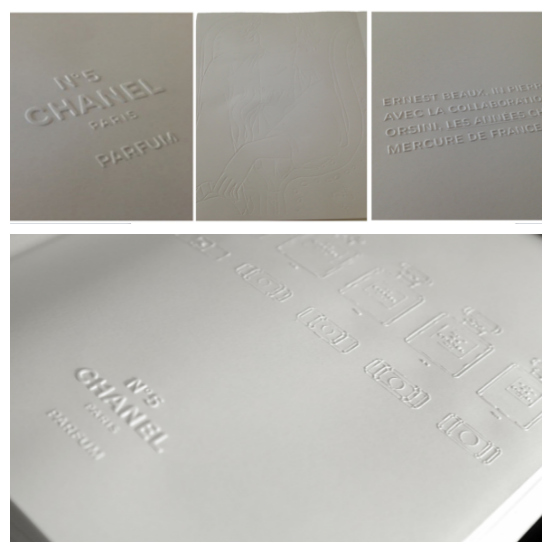 The entirely white book is embossed, rather than printed, and 5cm wide in homage to No. 5